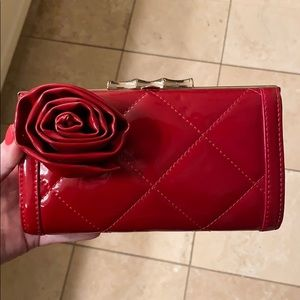 Elaine Turner red patent clutch with rose